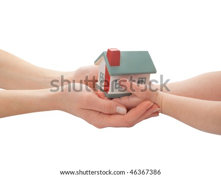 mother and child holding model of house - stock photo