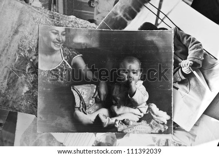 Mother and child in an old photograph - stock photo
