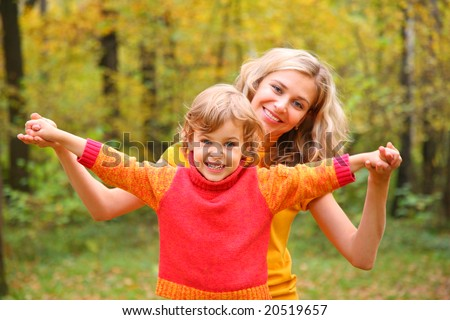 Mother and child in autumn forest