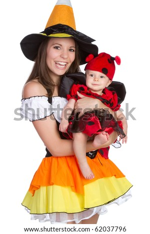Mother and child in Halloween costumes - stock photo