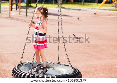 mother and child in the park enjoying a sunny day - stock photo