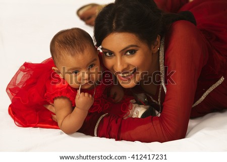 Mother and child looking in the camera - stock photo