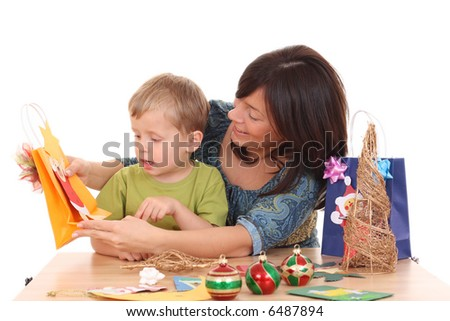 mother and child making Christmas decorations /all cards are made by mother and children/