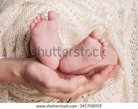 Mother and child. newborn baby in hands. - stock photo