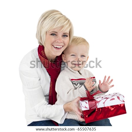 Mother and Child Opening Christmas Presents - stock photo