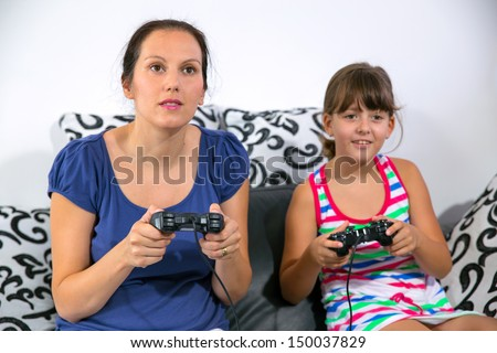 mother and child playing a video game - stock photo