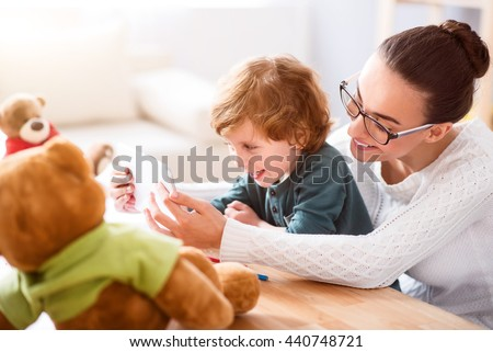 Mother and child playing on tablet - stock photo
