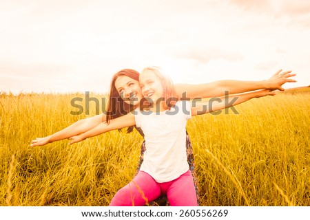 Mother and child pretend with hands they are together flying - photo with lens flare - stock photo