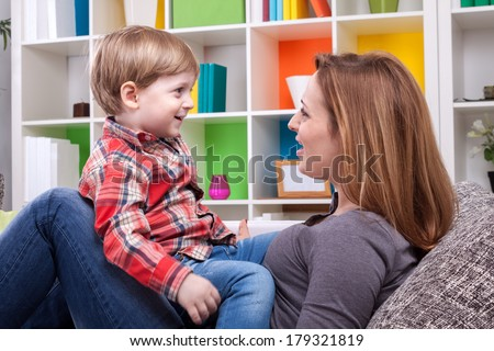 Mother and child singing a song - stock photo