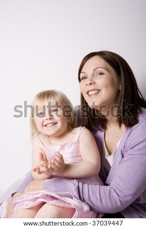 Mother and Child sitting together. - stock photo