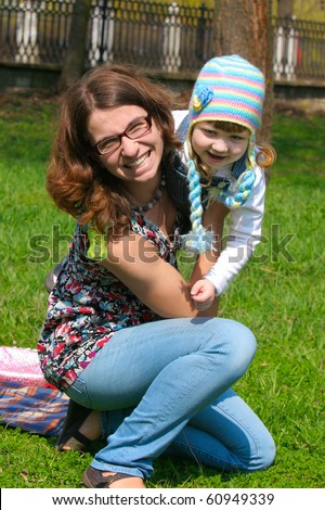 Mother and child take a wolr in park - stock photo