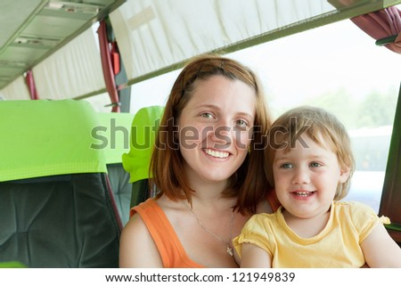 Mother and child traveling in autobus