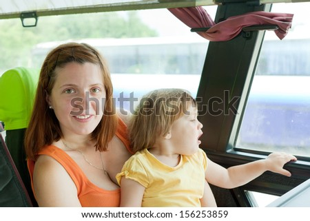 Mother and child traveling on commercial bus