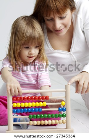 mother and child with abacus - stock photo
