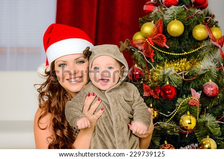 Mother and child with Christmas gift. Xmas holiday concept - stock photo