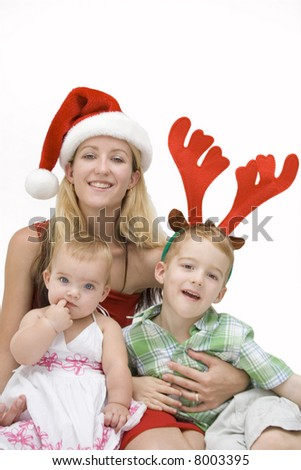 mother and children at christmas time isolated on white - stock photo
