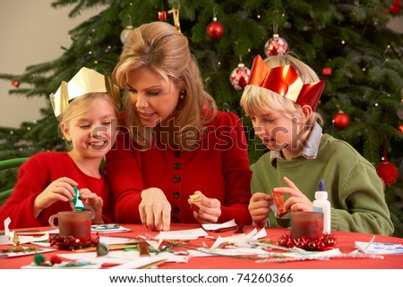 Mother And Children Making Christmas Cards Together - stock photo