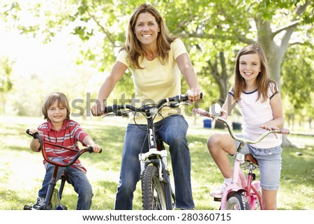 Mother and children on bikes - stock photo