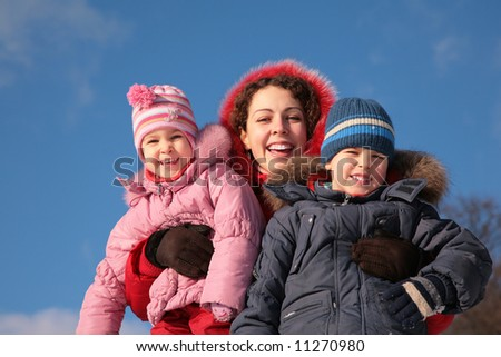mother and children outdoor in winter - stock photo