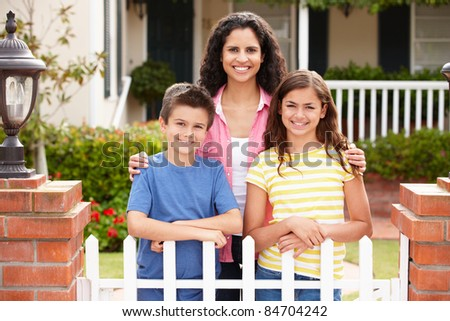 Mother and children outside home - stock photo