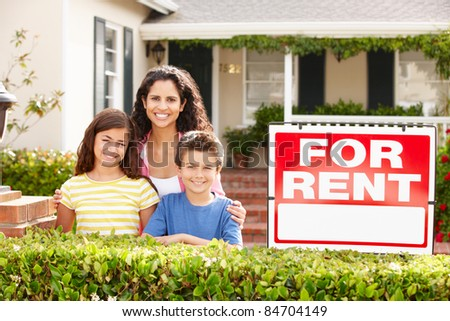 Mother and children outside home for rent - stock photo