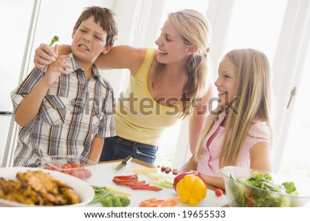 Mother And Children Prepare A meal,mealtime Together - stock photo