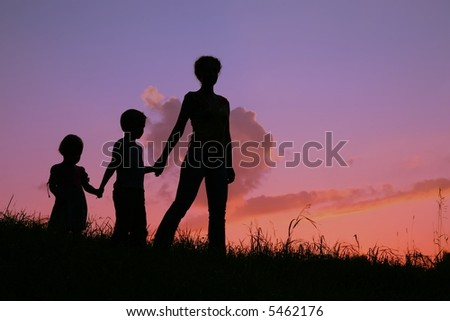 mother and children silhouette - stock photo