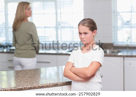 Mother and daughter after an argument at home in the kitchen - stock photo