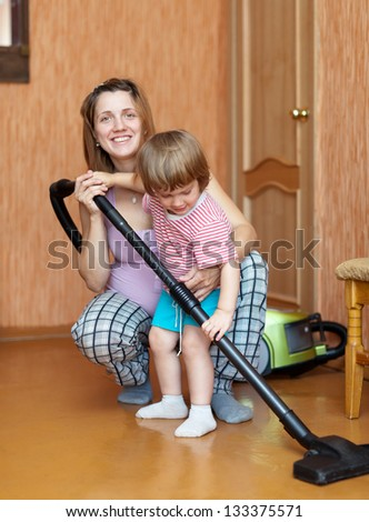 mother and daughter are doing house cleaning - stock photo