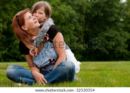 Mother and Daughter are happy in the park