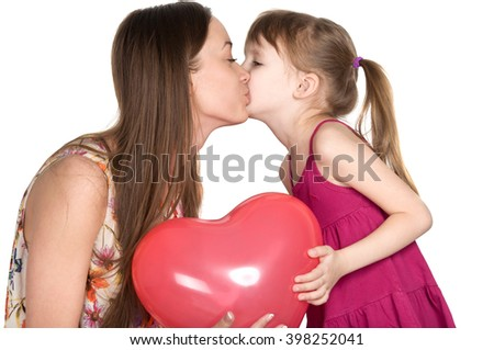 Mother and daughter are holding air ball in the form of red heart - stock photo