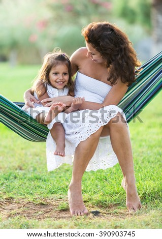 Mother and daughter are resting in the country side. - stock photo