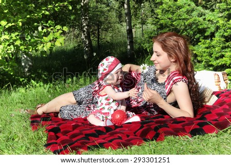 mother and daughter at a picnic - stock photo