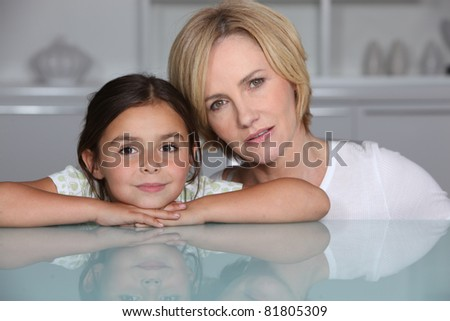 Mother and daughter at home - stock photo