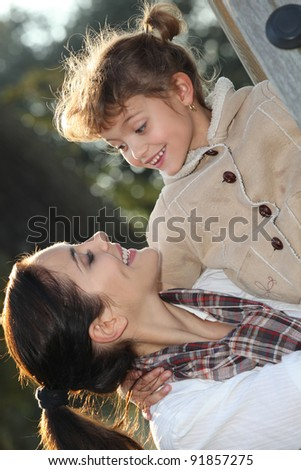Mother and daughter at the park - stock photo