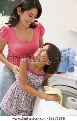 Mother And Daughter Doing Laundry - stock photo