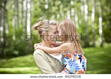 Mother and Daughter Embracing Each Other - stock photo