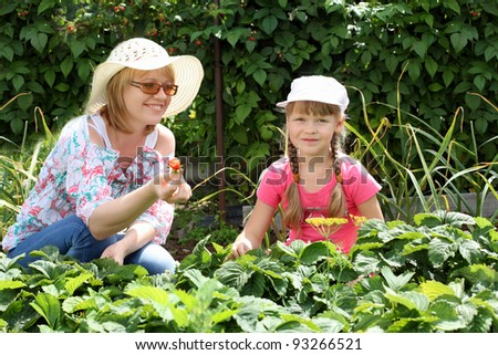 Mother and daughter engaged in gardening together - stock photo