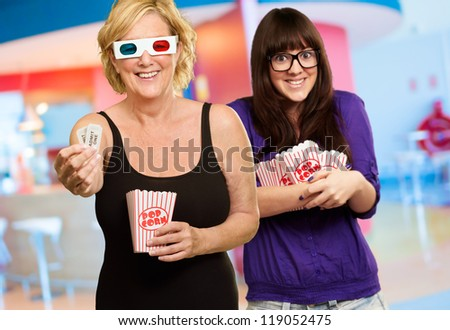 Mother And Daughter Enjoying 3d Movie, Indoors - stock photo