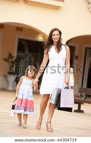 Mother And Daughter Enjoying Shopping Trip Together - stock photo
