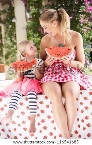 Mother And Daughter Enjoying Slices Of Water Melon - stock photo