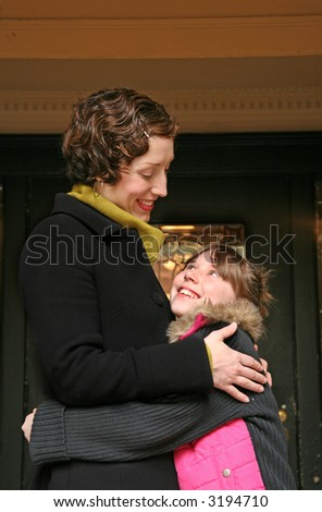 mother and daughter exchanging a greeting - stock photo