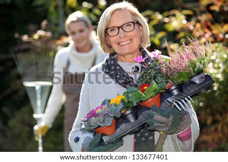 Mother and daughter gardening - stock photo
