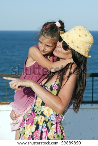 Mother and daughter having a play and social time - stock photo