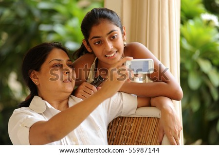 mother and daughter having fun - stock photo