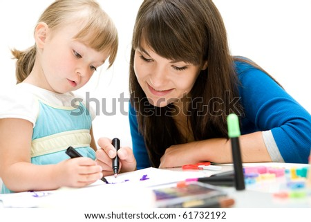 mother and daughter having fun in kindergarden - stock photo