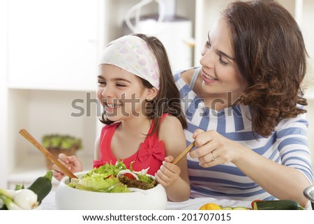 Mother and daughter having fun making healthy launch - stock photo