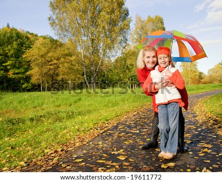Mother and daughter having fun outdoors - stock photo
