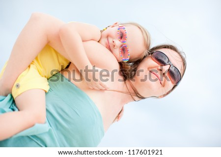 Mother and daughter having fun outdoors on summer day
