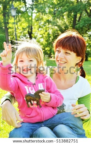 mother and daughter having fun outside